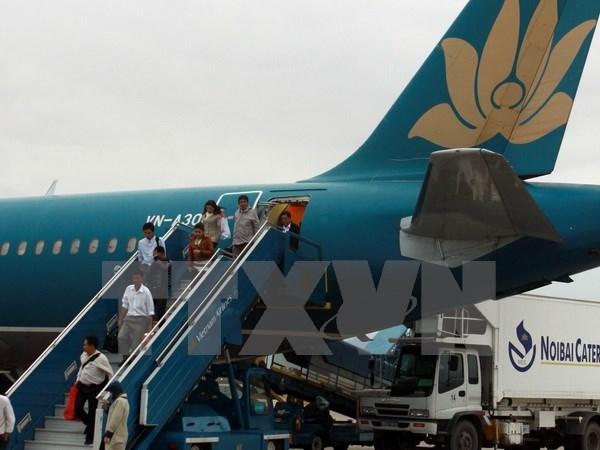 Hành khách trên chuyến bay của Vietnam Airlines. (Ảnh: TTXVN)