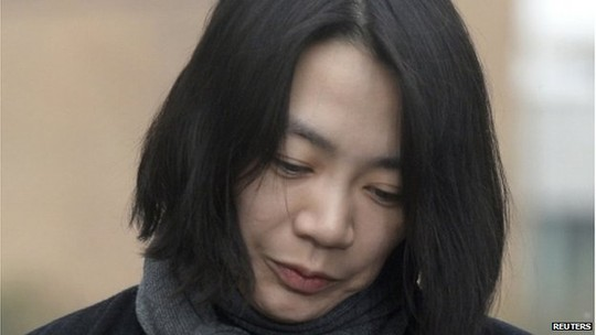 Cho Hyun-ah, also known as Heather Cho, daughter of chairman of Korean Air Lines, Cho Yang-ho, appears in front of the media outside the offices of the Aviation and Railway Accident Investigation Board of the Ministry of Land, Infrastructure, Transport, in Seoul 12 December 2014