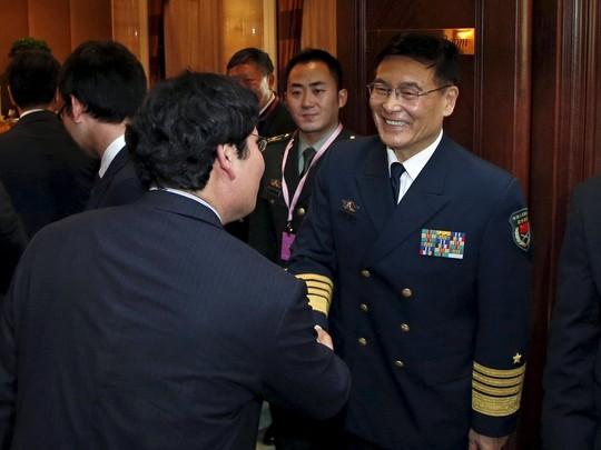 Đoàn Trung Quốc tại một hoạt động bên lề Shangri-La. Ảnh: Reuters