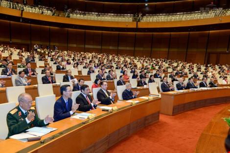 Các đại biểu Quốc hội tại phiên khai mạc kỳ họp thứ 11, Quốc hội khóa XIII diễn ra sáng 21-3.