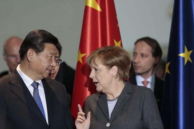 Chủ tịch Trung Quốc Tập Cận Bình và Thủ tướng Đức Merkel.