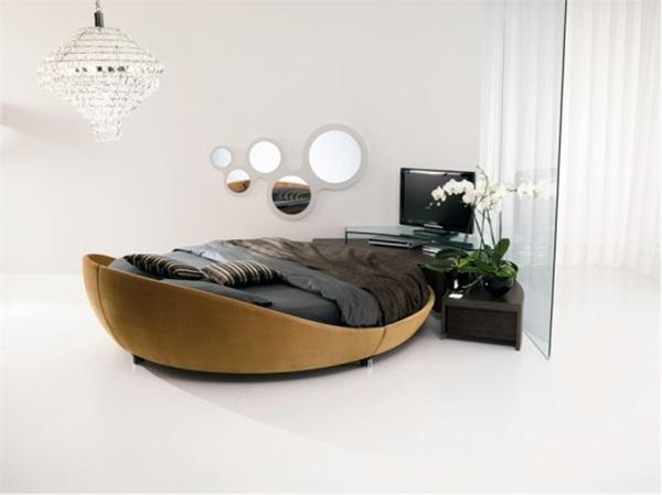 Một chiếc giường hình oval tuyệt đẹp này cũng đủ mang đến luồng gió mới vào phòng ngủ nhà bạn.