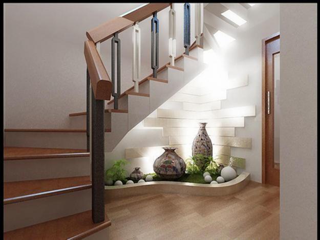 Bạn cũng có thể cải tạo gầm cầu thang thành không gian lãng mạn, với tiểu cảnh, cây xanh, đèn chiếu sáng hoặc mang ý nghĩa phong thủy, cầu may mắn tài lộc.