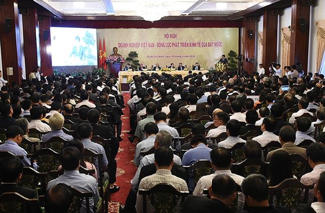 Số lượng khách mời tại điểm cầu TPHCM là 500 nhưng thực tế đã lên tới 1.000 người, cùng với 10.000 đại biểu tại các điểm cầu khác. Ảnh: VGP