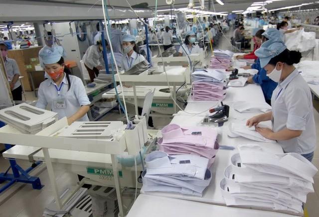 Sản xuất may mặc của Việt Nam. (Ảnh: Vũ Sinh/TTXVN)