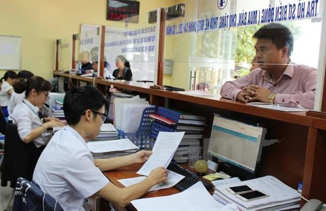 Văn phòng Đăng ký đất đai Hà Nội cắt giảm 30 đến 50 thủ tục. (Ảnh: PV/Vietnam+)