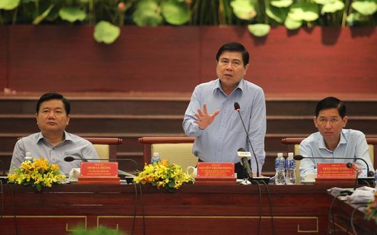 Ông Nguyễn Thành Phong khẳng định TP sẵn sàng hỗ trợ và tạo môi trường kinh doanh thuận lợi cho DN.