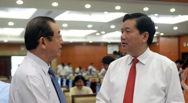 Bí thư Thành ủy Đinh La Thăng và ông Huỳnh Thành Lập tại kỳ họp thứ nhất HĐND TP.HCM - Ảnh: Tự Trung